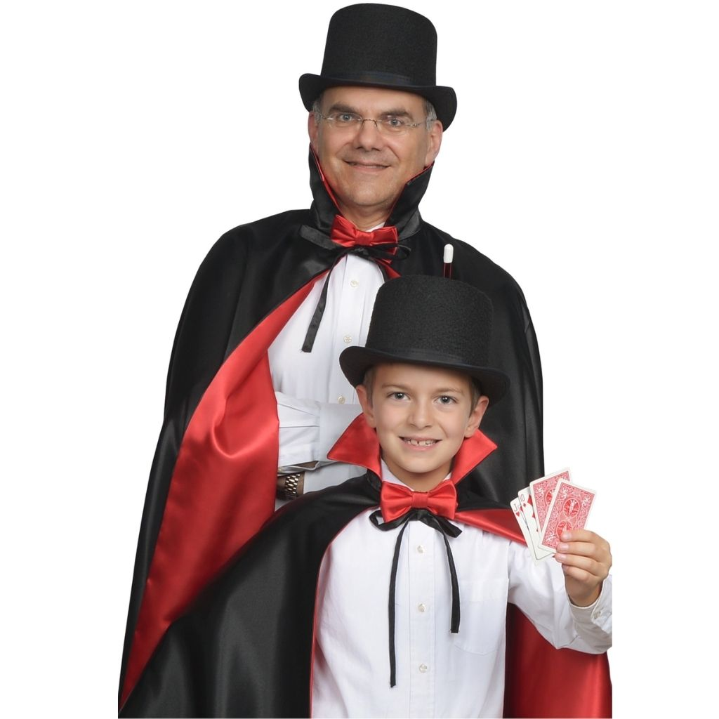 adult and child dressed up in magician hats and capes