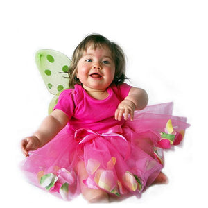 infant wearing fairy wings and pink tulle tutu with flower petals