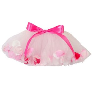 white tulle fairy tutu with flower petals and pink bow