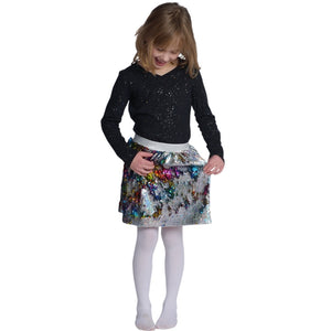 girl wearing multicolor flippy sequin skirt
