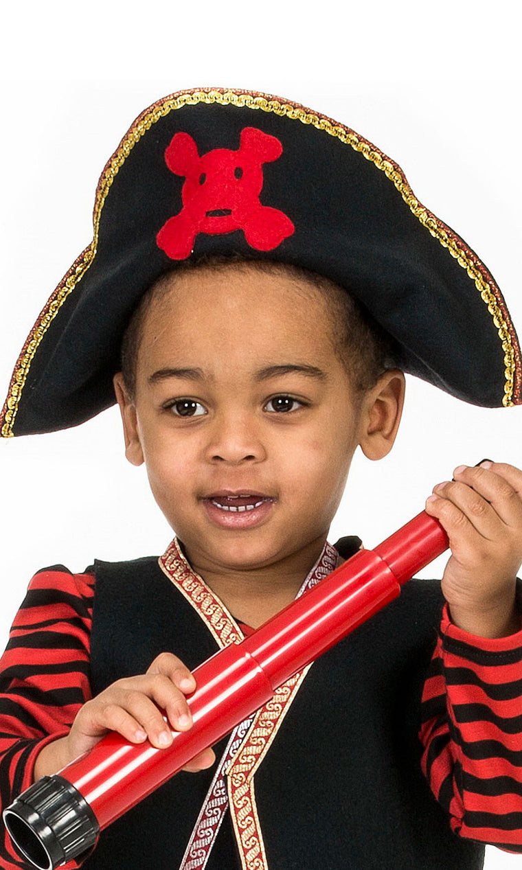 boy wearing pirate hat with red skull and crossbones