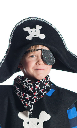 boy wearing pirate hat with red skull and crossbones, eyepatch and pirate bandana