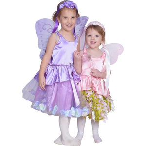 two girls dressed up in fairy costumes purple and pink