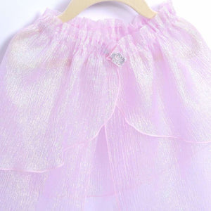 closeup of pink shimmery cape with jewel clasp