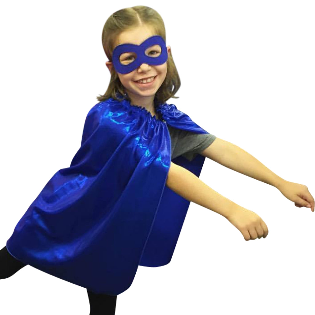 child wearing blue superhero mask and superhero cape