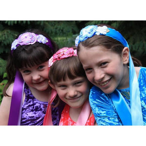 girls wearing flower and ribbon headbands