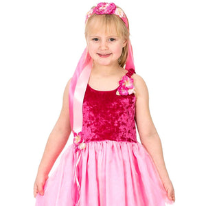 Girl wearing pink flower ribbon headband and princess dress