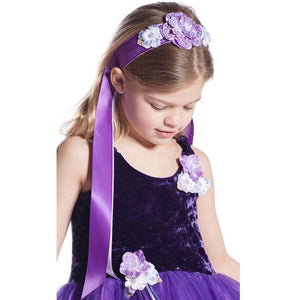 Girl wearing purple flower ribbon headband