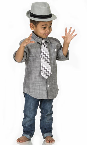 Toddler wearing Fly Guy necktie in gray zigzag print