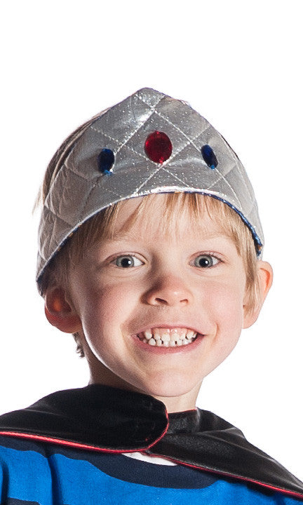 boy dressed up in toy silver metallic crown with jewel details