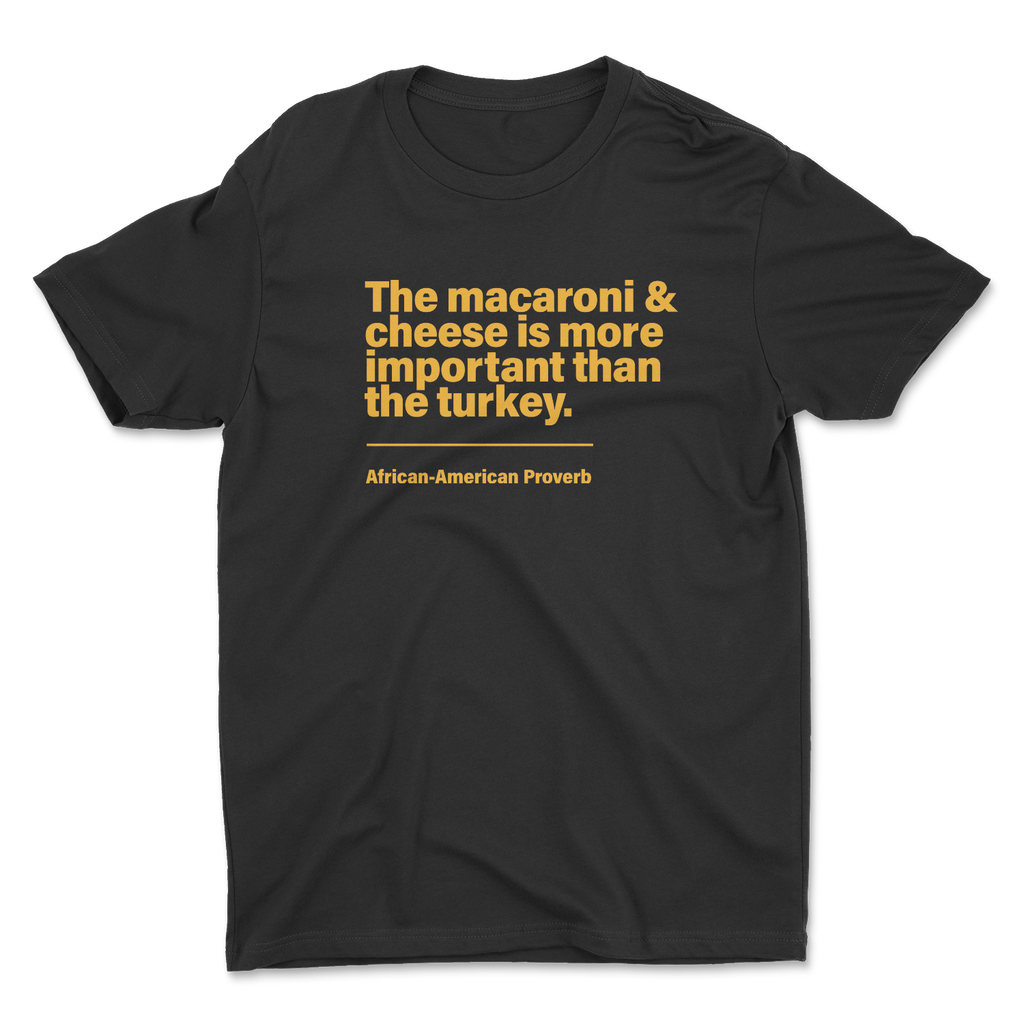 Shirt with the words macaroni and cheese is more important than the turkey