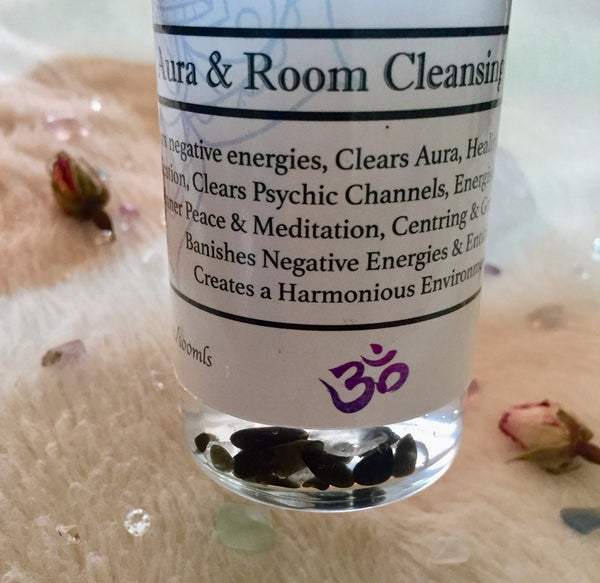 Aura & room clearing and protection spray close up of crystal chips. Product by Celestial Bliss Holistic