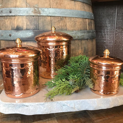 Shiny hammered solid copper canister set