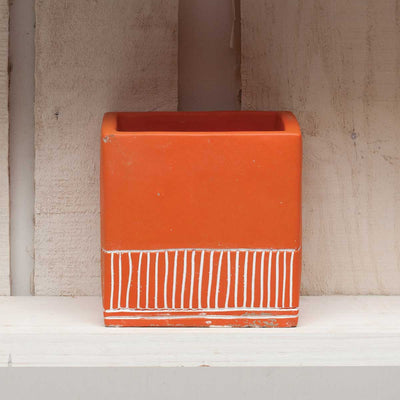 Orange square pot with strips