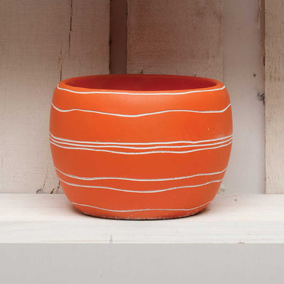Orange round pot with strips