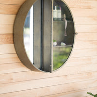 metal round framed mirror with shelves
