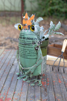 repurposed military canister frog planter