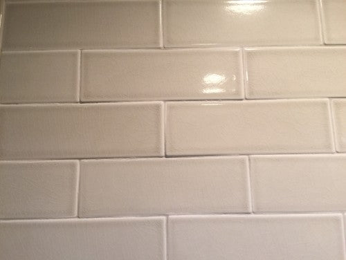 Uneven Level of Tiles on Wall