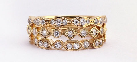 image of yellow gold and diamond stacked engagement and wedding rings.