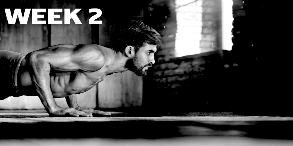 Week 2 header showing a man doing pushups in black and white