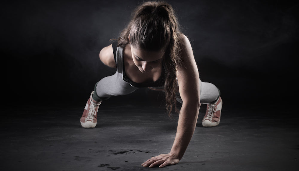 Woman doing one-handed pushup