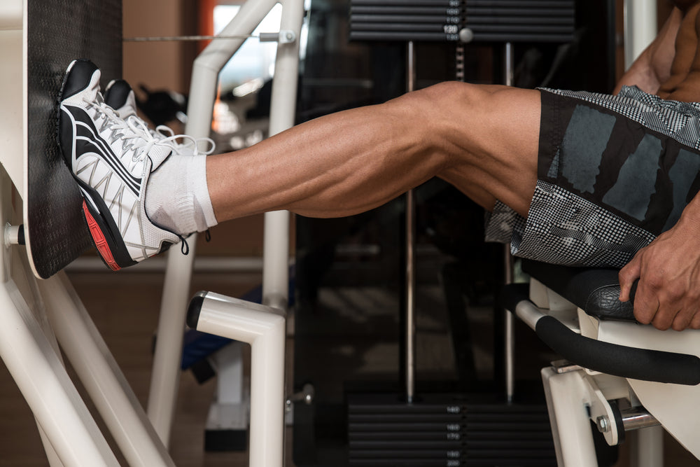 Man working out calf muscles on leg press machine