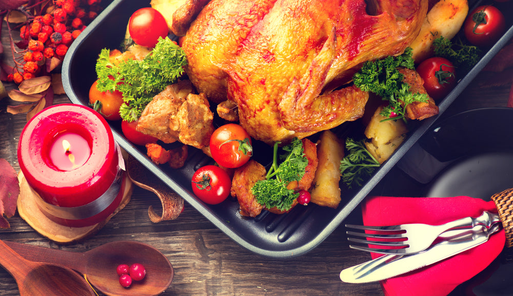 Turkey dinner in roasting pan with vegetables