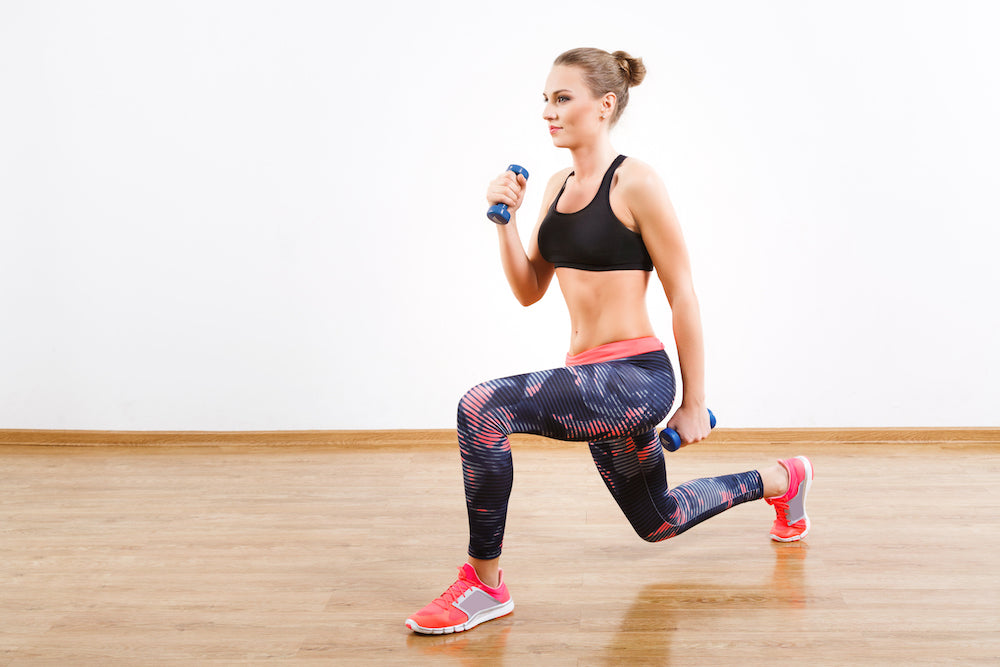 Woman performing dumbbell walking lunges