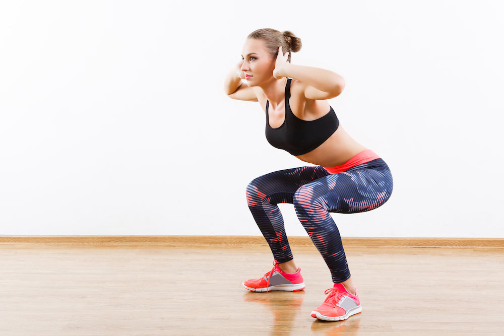 Woman performing bodyweight squat