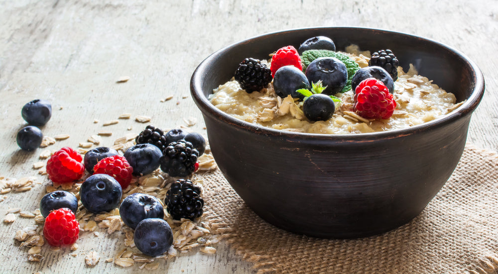 Porridge made with protein powder in a bowl with berries