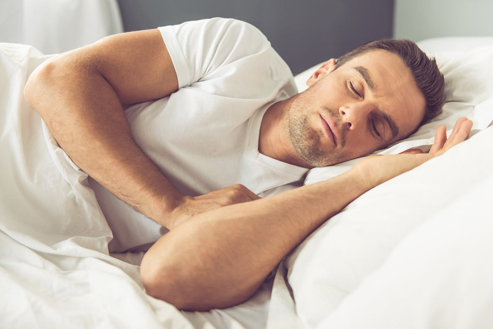 Man sleeping comfortably in bed