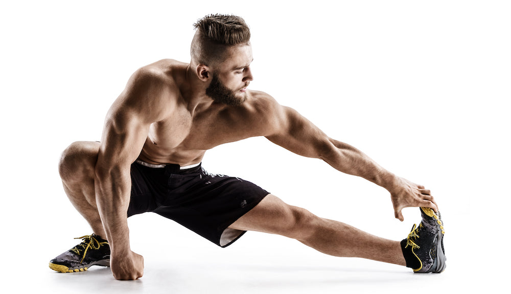 Fit man stretching hamstrings