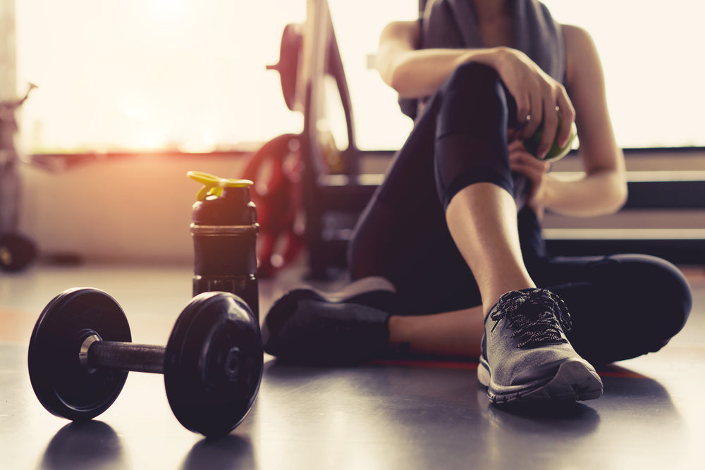 Woman resting in gym after workout