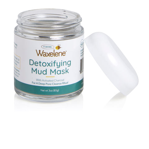 open glass jar, detoxifying mud mask, with activated carbon, for a deep pore cleanse ritual, waxelene