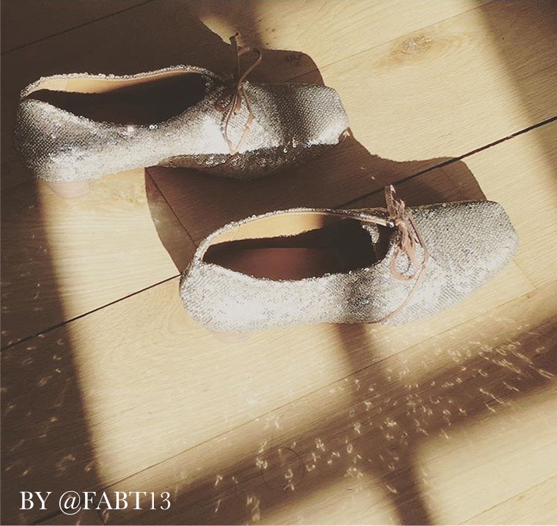 sparkling shoes on wooden floor with window shadow