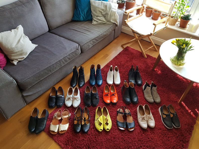 A colourful collection of Summer and Winter shoes by designer Tracey Neuls, displayed on living room floor