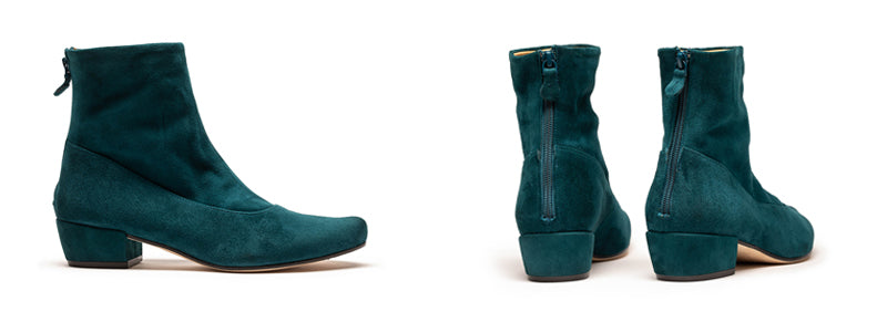Product photograph of turquoise green suede designer boots
