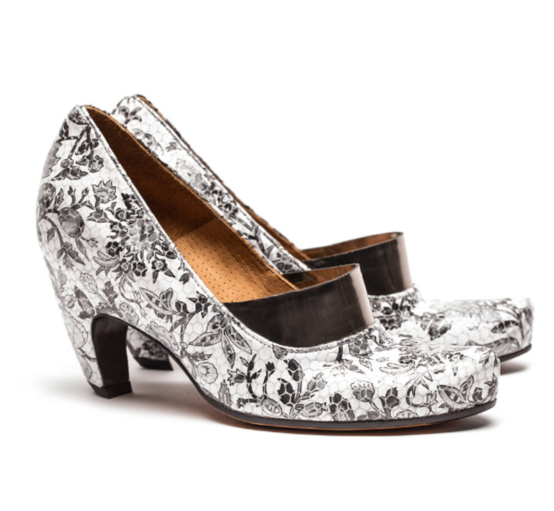 A pair of High Heel designer shoes by Tracey Neuls in luxury black and white floral printed leather