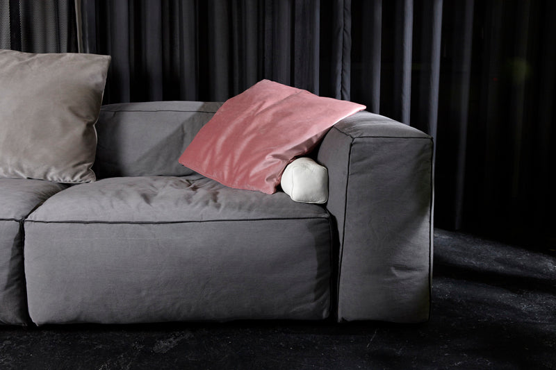 Elementary store Shoreditch Redchurch White cushion and pink cushion on grey sofa, minimal stylish scandinavian interior design