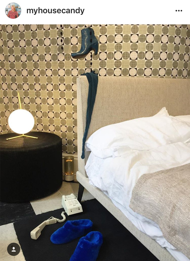 Instagram screen shot of a bedroom interior with slippers and a lamp