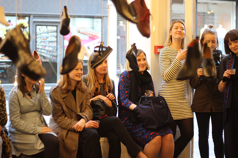Women in the shoe shop in marylebone lane enjoying a talk