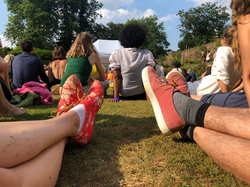 Lounging on the grass in Tracey Neuls leather sneakers for men and women KARL and GEEK
