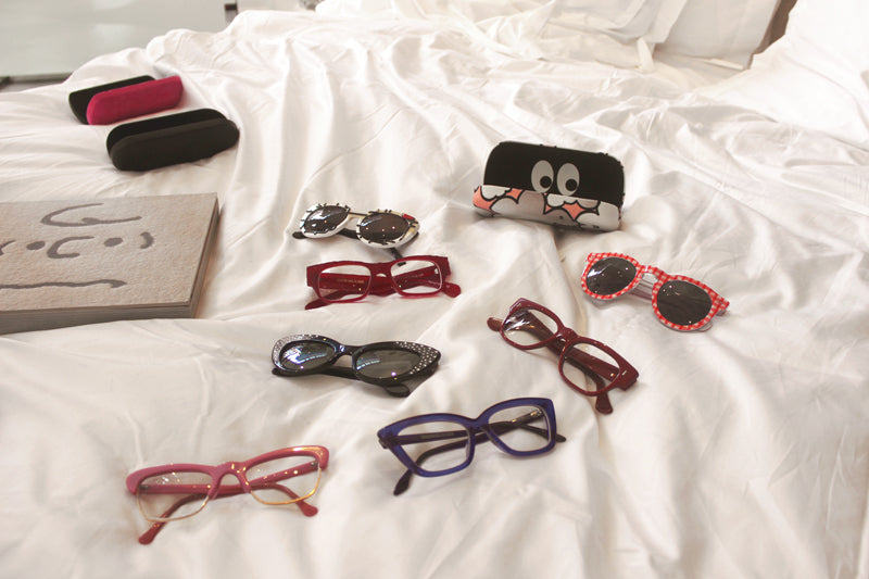 Cutler and gross sunglasses and glasses on a Matthew Hilton bed in Tracey Neuls shoe shop