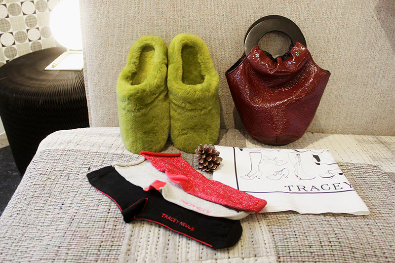 womens christmas gift guide green slippers tea towel bag glitter socks on bed