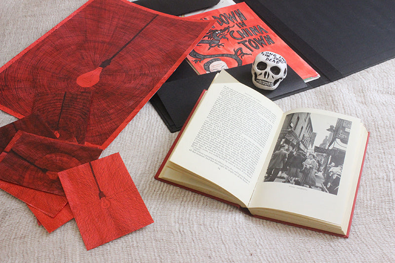red arkwork displayed on a bed by le gun robbert rubbish with skull