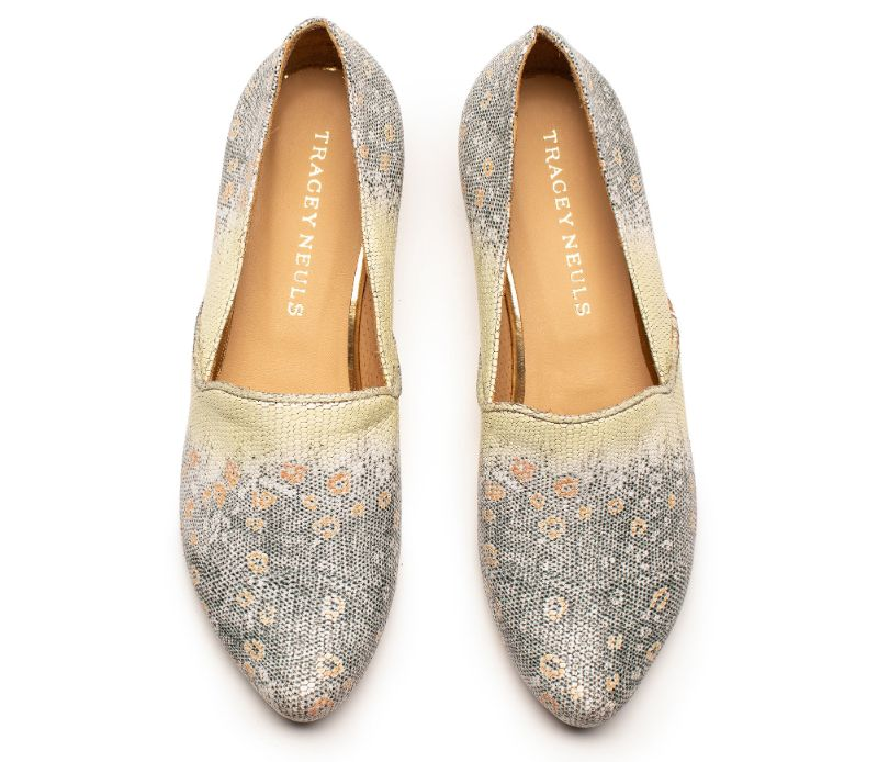 A pair of designer leather loafers in faux lizard print by designer Tracey Neuls