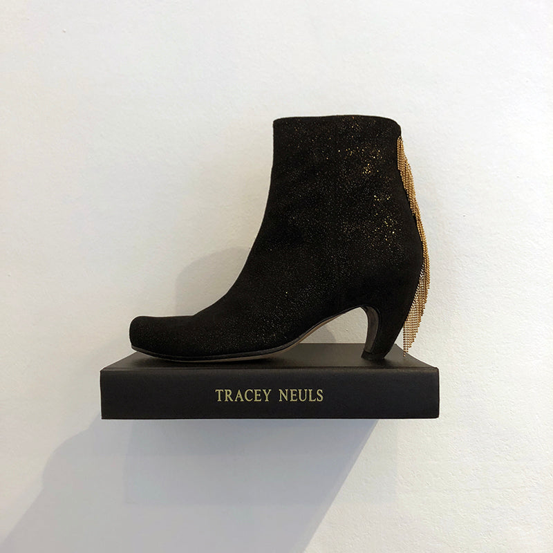 Tracey Neuls Gold Line Calvin Boot on a Book Shelf