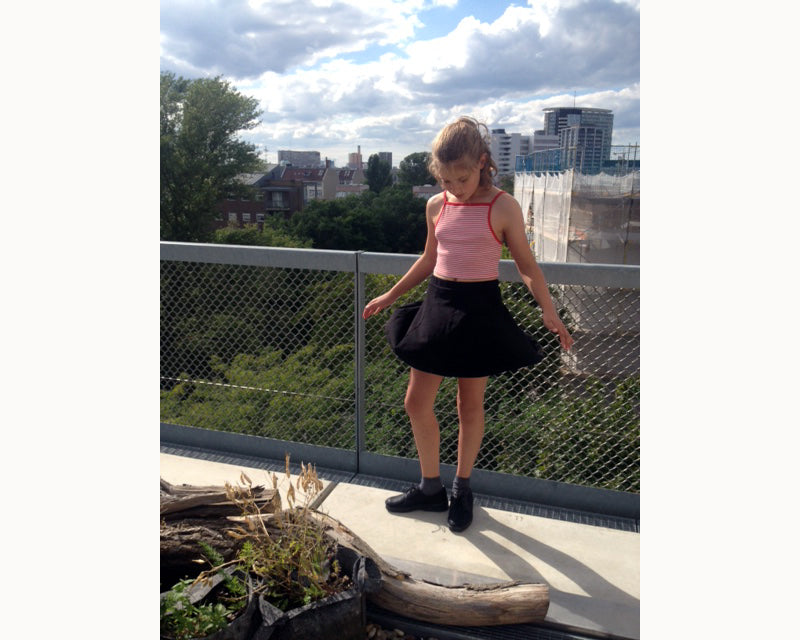 young girl in skirt with view in dean shoes
