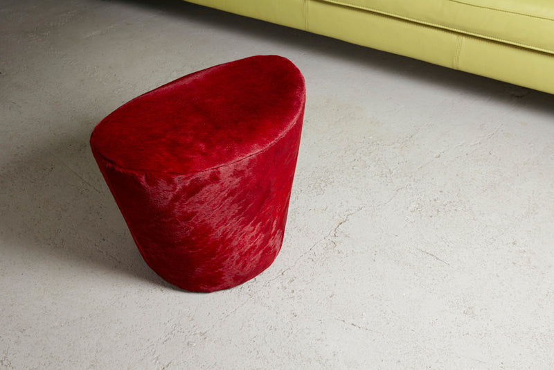 Red fur stool cushion chair in Elementary store Shoreditch Redchurch white cushion and pink cushion on grey sofa, minimal stylish scandinavian interior design