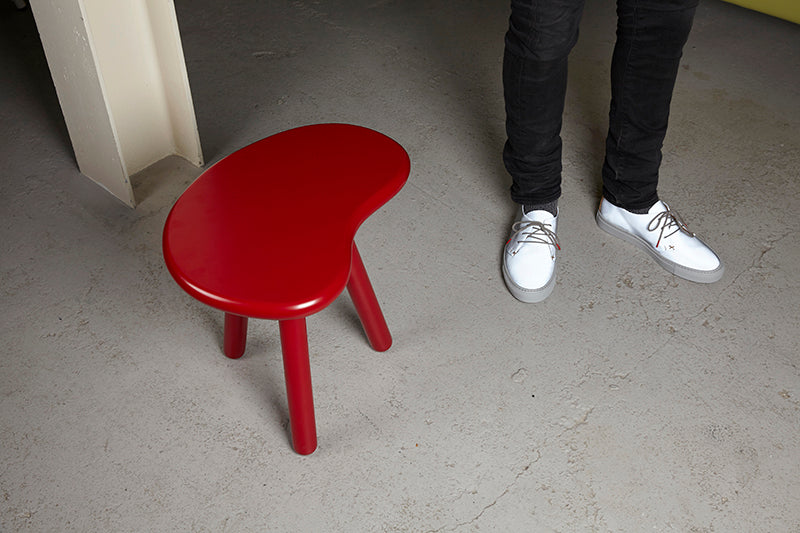 Tracey Neuls white Mens fashion shoes on grey floor in Elementary store Shoreditch Redchurch Street with a red chair stool